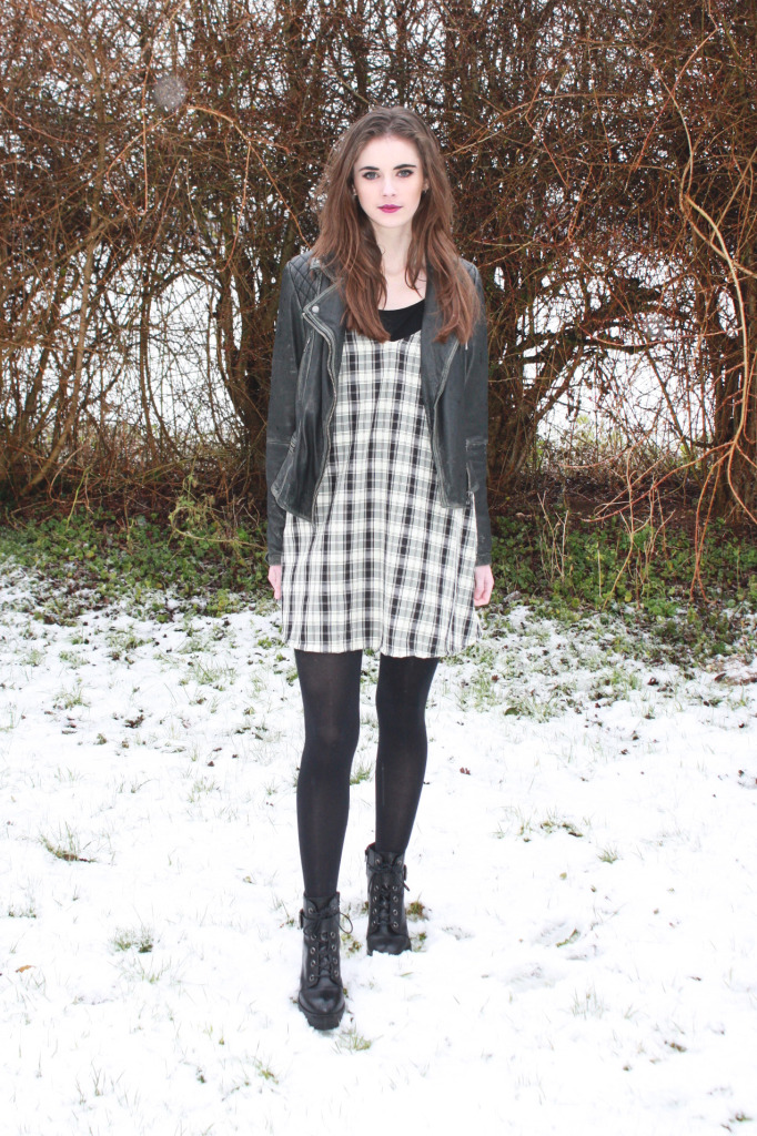 DIY plaid pinafore dress styled with leather jacket